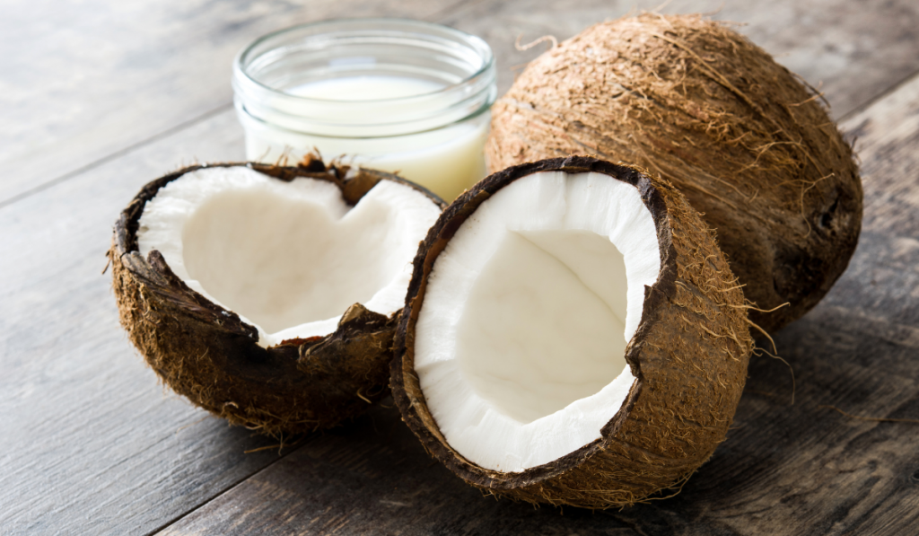 Coconut with coconut milk on the wood