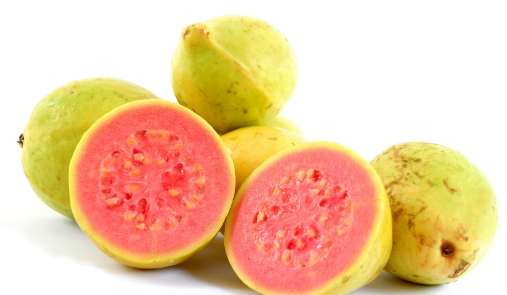 Green guavas and sliced guava