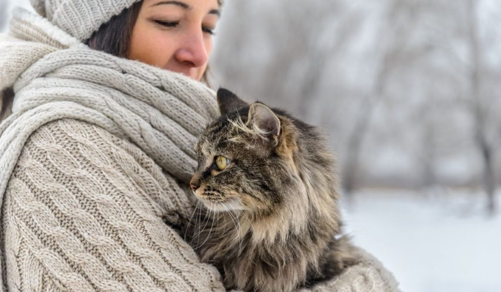 woman carrying her cat