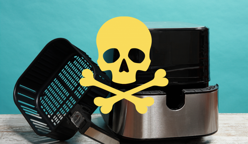 An air fryer on the table with a toxic sign on a blue green background.